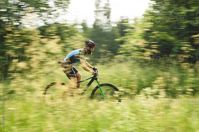 Mountain biker riding in the forest by Aleksandar Novoselski for Stocksy United