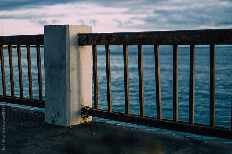 Through the boardwalk railing by Benj Haisch for Stocksy United