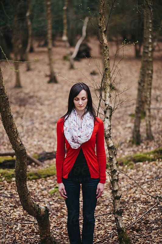 Young woman standing in woods by Gabriel Tichy for Stocksy United