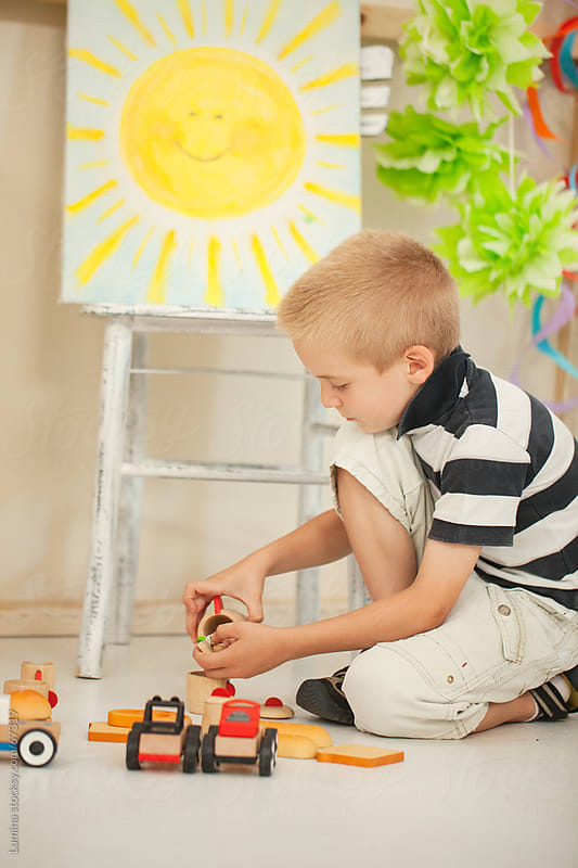 Boy Playing With Wooden Toys by Lumina for Stocksy United