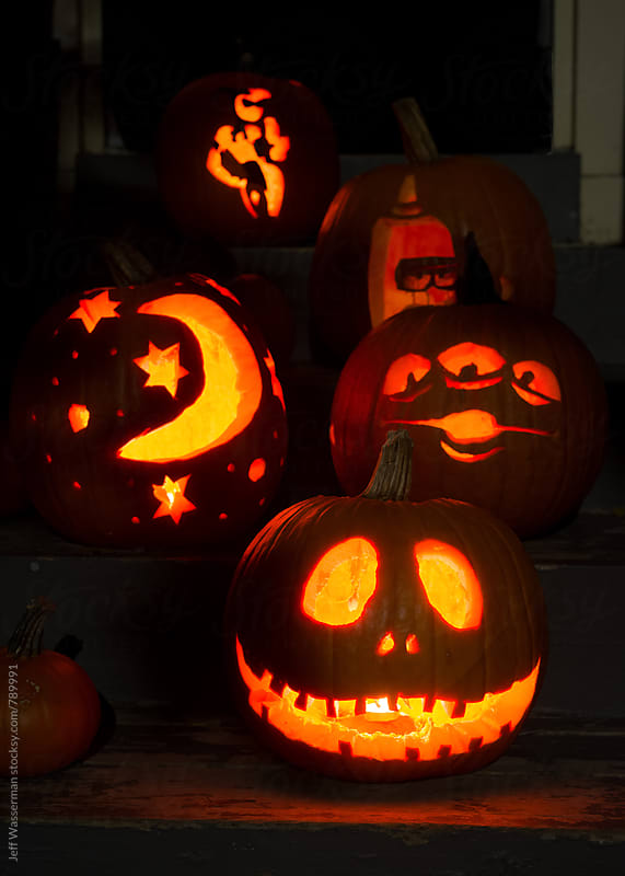 Carved Pumpkins on Porch at Night by Jeff Wasserman for Stocksy United