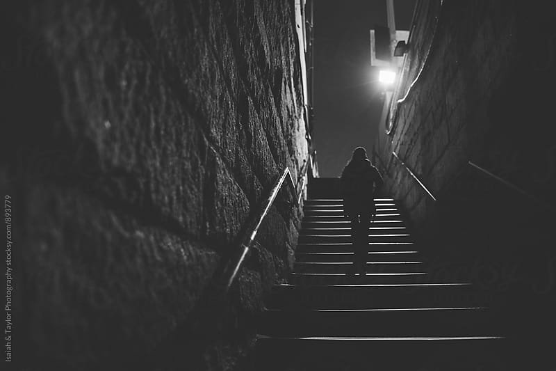 Woman walking up stairs by Isaiah & Taylor Photography for Stocksy United