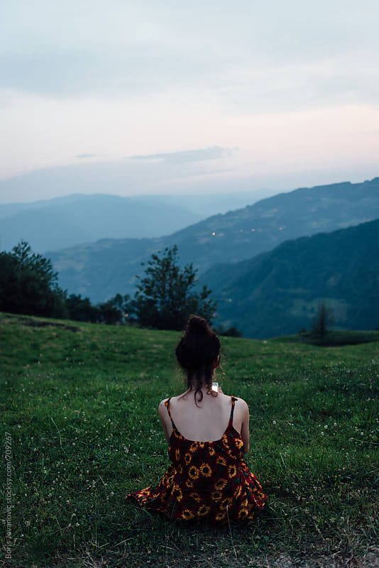 Young woman using a mobile phone in the nature by Boris Jovanovic for Stocksy United