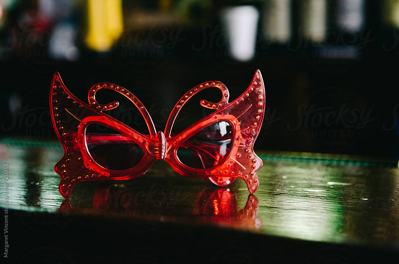 red butterfly sunglasses by Margaret Vincent for Stocksy United