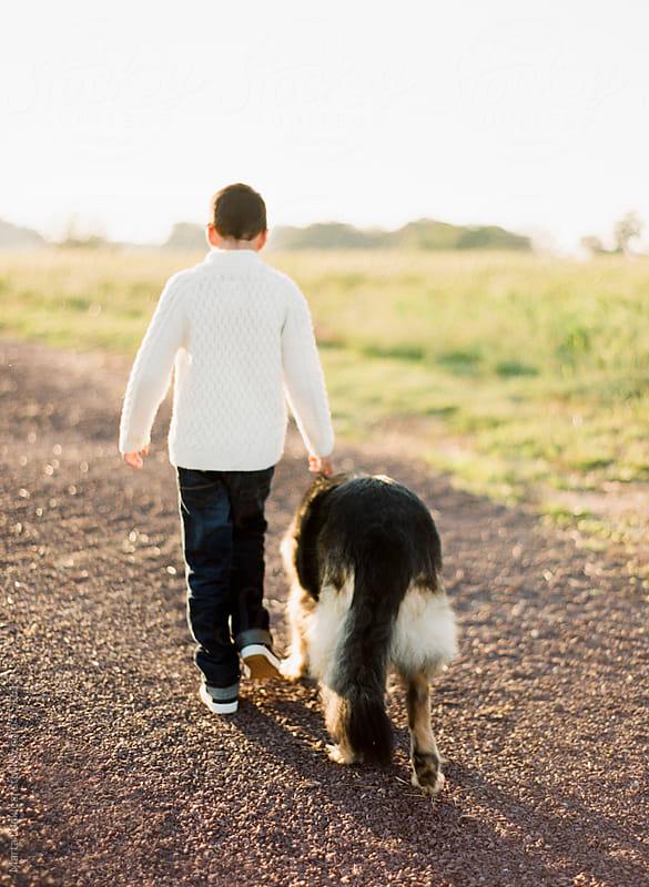 A Boy & His Dog by Marta Locklear for Stocksy United