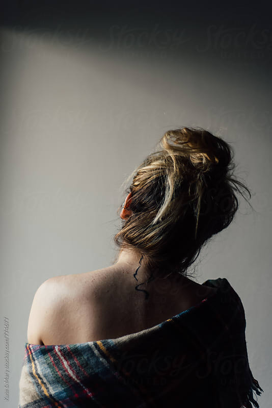 Back portrait of woman with tattoo by Katarina Simovic for Stocksy United