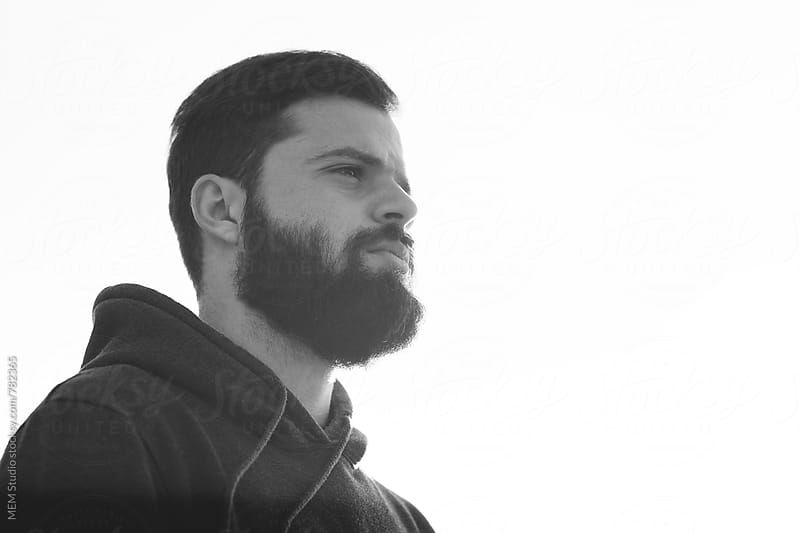 young bearded man portrait by MEM Studio for Stocksy United