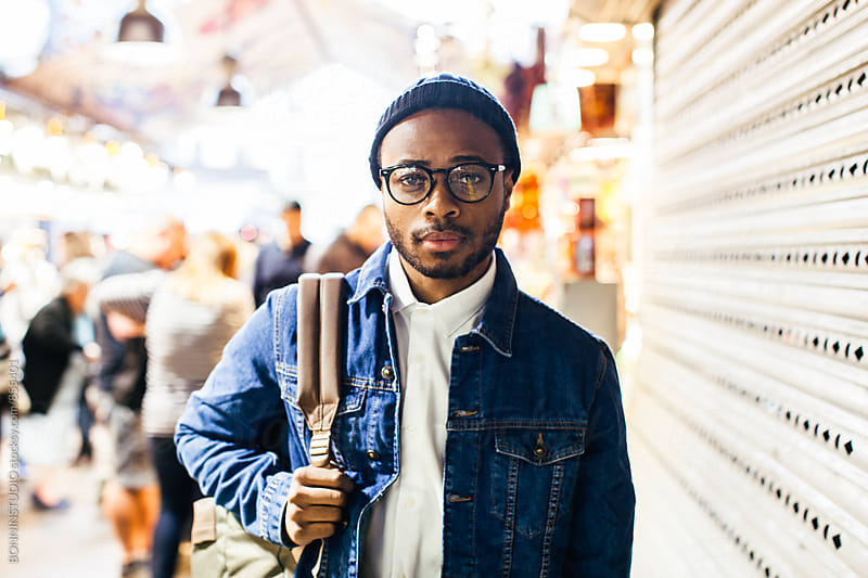 African american man standing in a marketplace. by BONNINSTUDIO for Stocksy United