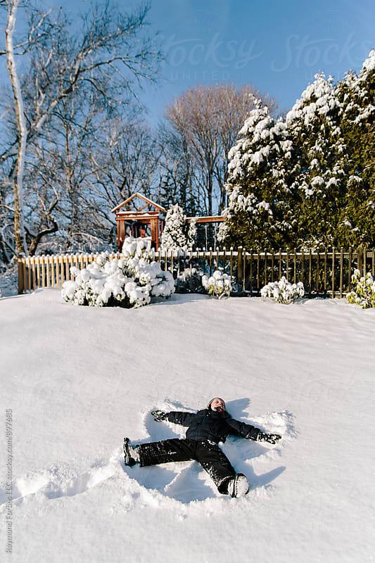 Fresh Snow Angel by Raymond Forbes LLC for Stocksy United