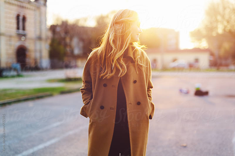 Beautiful blond woman at sunset in the city by Good Vibrations Images for Stocksy United