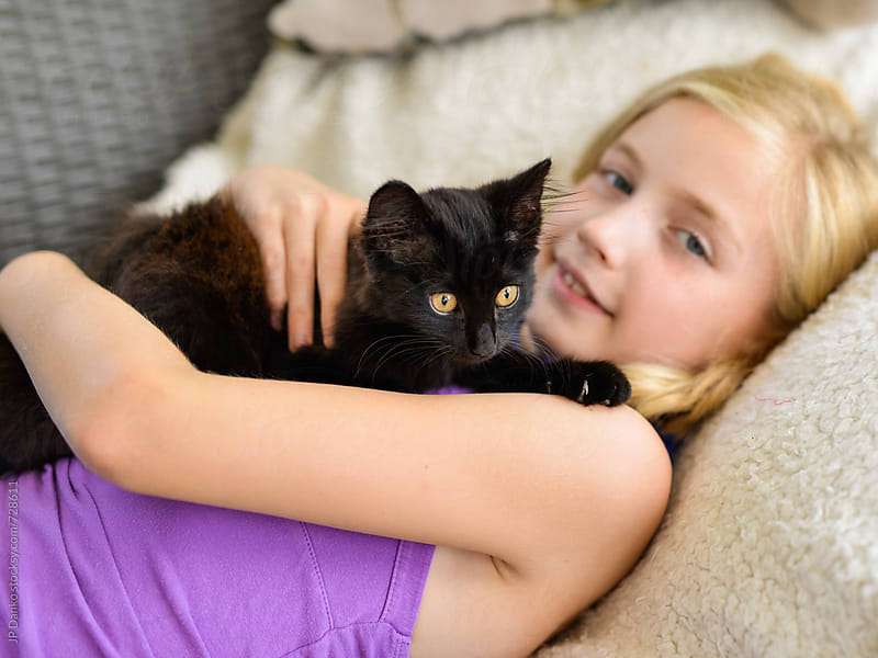 Happy Little Girl Snuggling With Rescued Stray Kitten by JP Danko for Stocksy United