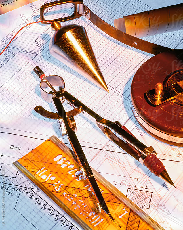 Work tools on architectural blueprints by J.R. PHOTOGRAPHY for Stocksy United