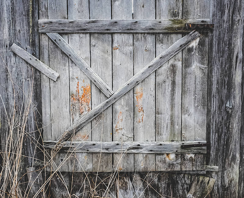 old weathered wooden door by Andreas Gradin for Stocksy United