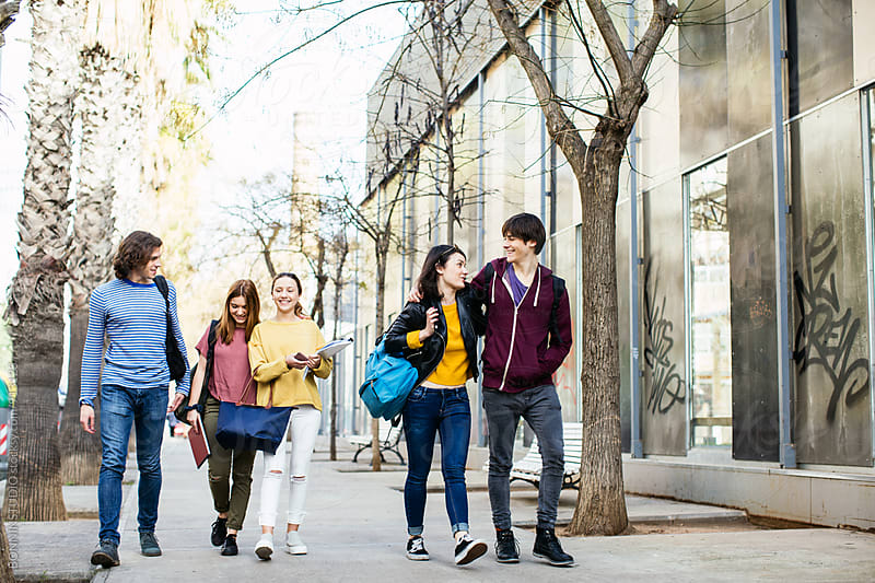 Group of teen students walking on the street. by BONNINSTUDIO for Stocksy United