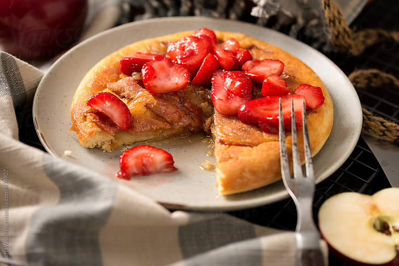 Decadent Baked Apple and Bacon Pancake with Strawberries by Jeff Wasserman for Stocksy United