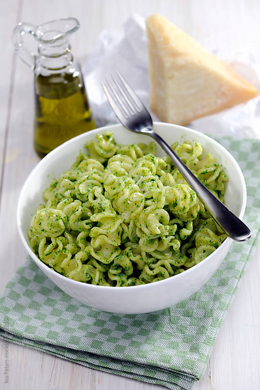 Bowl of Fusili pasta with pesto pesto by Ina Peters for Stocksy United