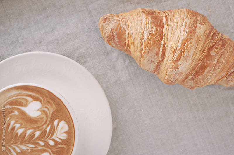 coffee and croissant by Gillian Vann for Stocksy United