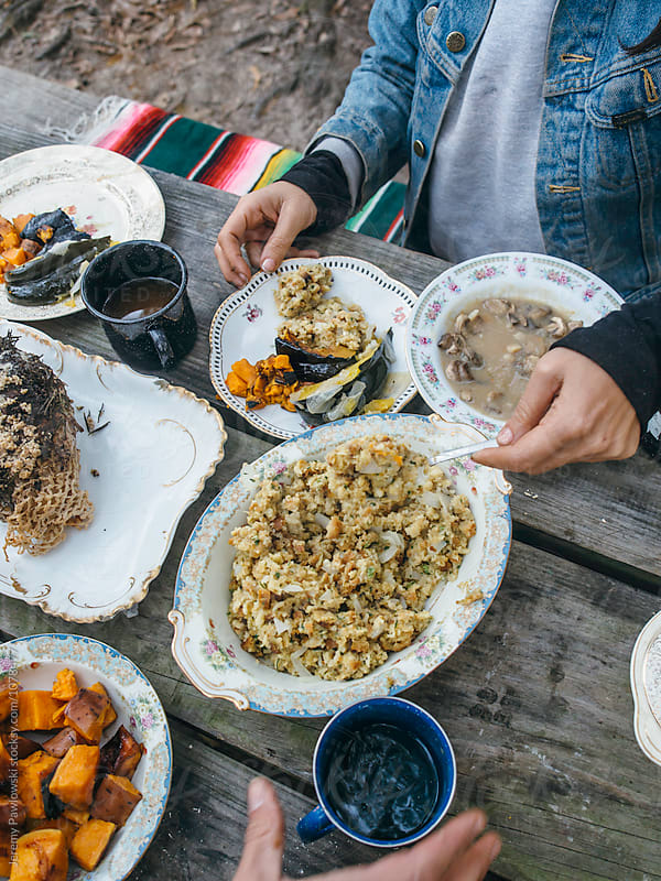 Serving up stuffing from a rustic Thanksgiving meal by Jeremy Pawlowski for Stocksy United