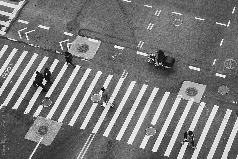 Overhead shot of people walking in the city by Lauren Naefe for Stocksy United