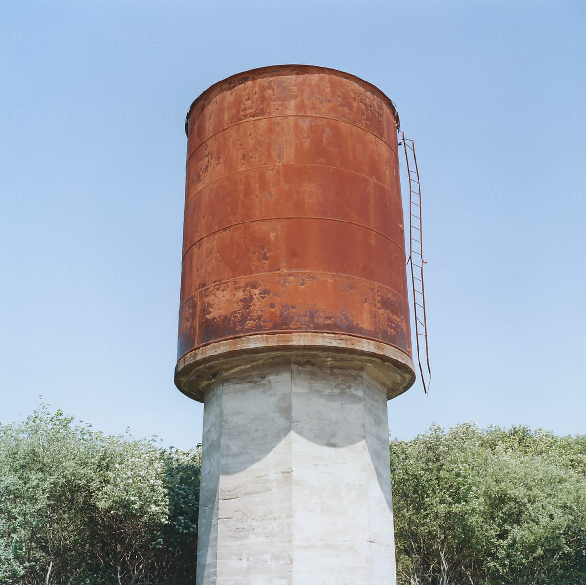 Stock Photo - Abandoned Rusty Water Tower In Field