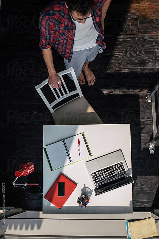 Working desk from above - young designer working from home by Jovo Jovanovic for Stocksy United