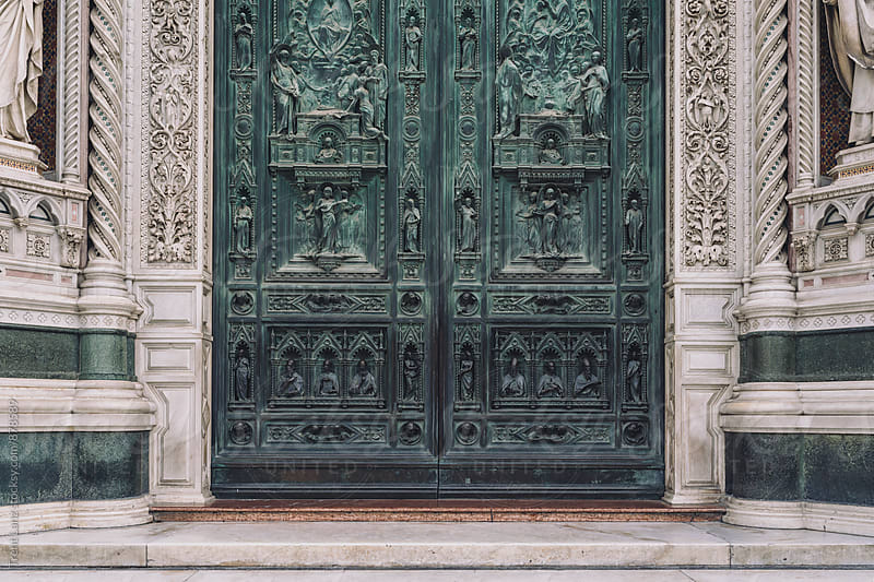 View of beautifully carved sculptures in stone doors by Trent Lanz for Stocksy United
