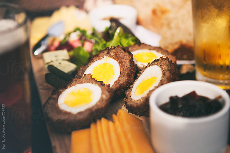 Scotch Eggs On British Ploughman's Plate  by Sean Locke for Stocksy United