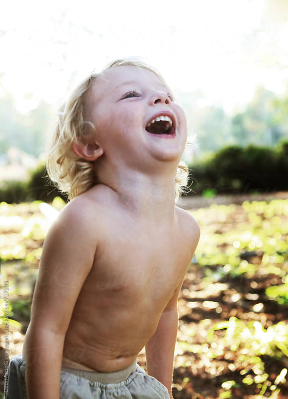 Little Blonde Boy Laughing by Dina Giangregorio for Stocksy United