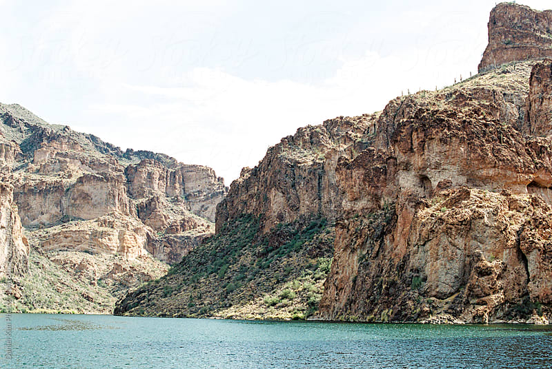 Lake and cliffs in Arizona by Daniel Kim Photography for Stocksy United