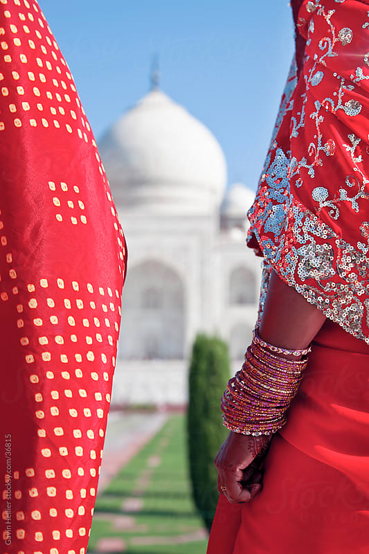 Taj Mahal, UNESCO World Heritage Site, Women in colourful Saris, Agra, Uttar Pradesh state, India, Asia by Gavin Hellier for Stocksy United