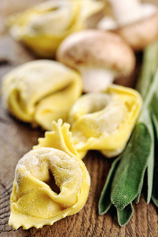 Fresh homemade Tortelloni, sage and mushrooms by Ina Peters for Stocksy United