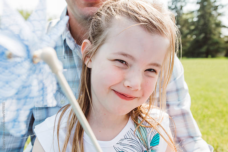 Happy young girl smiling at the camera by Carey Shaw for Stocksy United