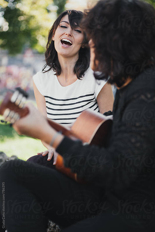 Musicians playing in a park by Giada Canu for Stocksy United