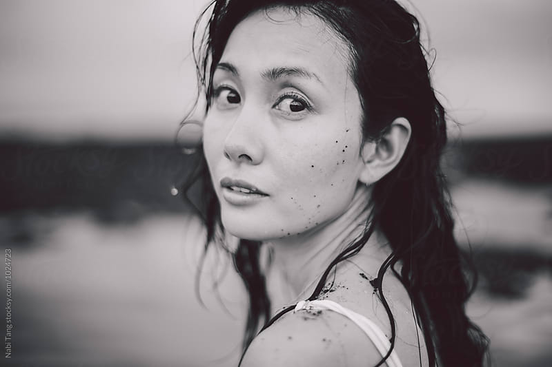 Black and white portrait of beautiful Japanese woman at the beach in Indonesia by Nabi Tang for Stocksy United