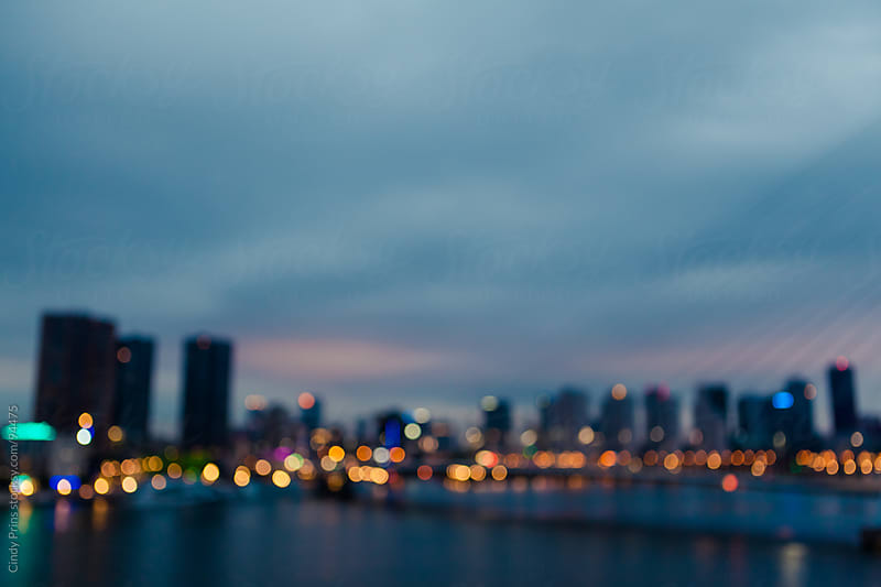 Blurred skyline of Rotterdam in the Netherlands during sunrise by Cindy Prins for Stocksy United
