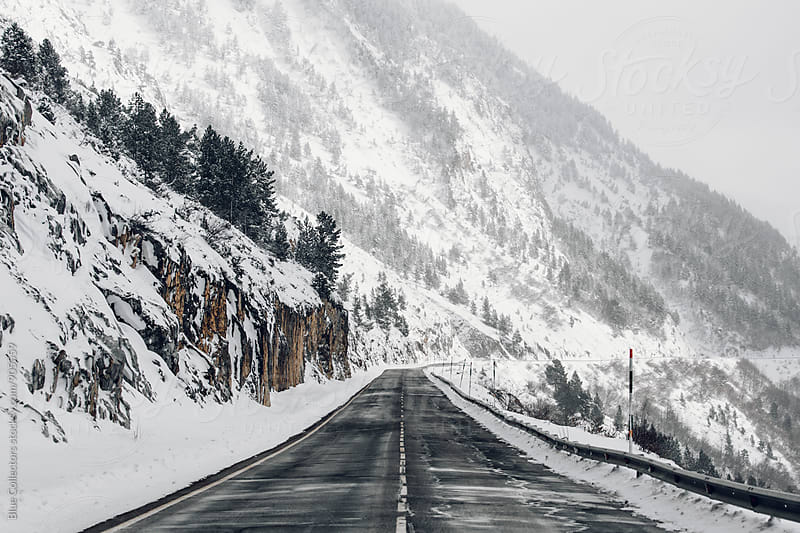 Winter road in the snowy mountain by Jordi Rulló for Stocksy United