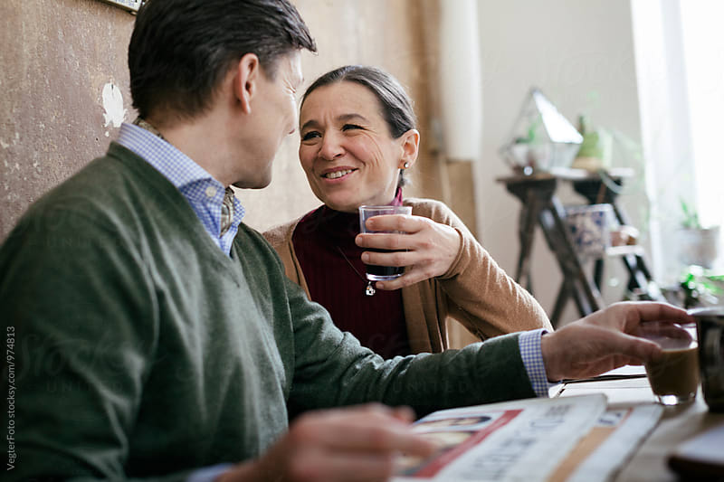 Mature Couple enjoying a Coffee by VegterFoto for Stocksy United