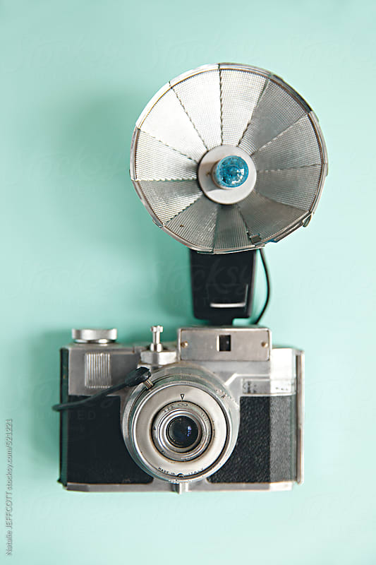 vintage / old film camera with flash attached by Natalie JEFFCOTT for Stocksy United