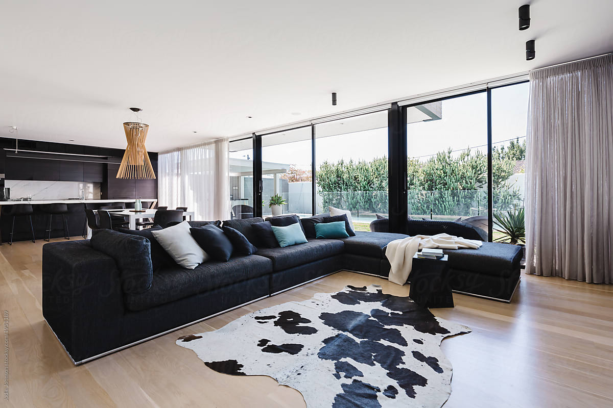 Spacious Living Room With Cowhide Rug And Charcoal Fabric Sofa By Jodie Johnson Photography Living Room Luxury Stocksy United