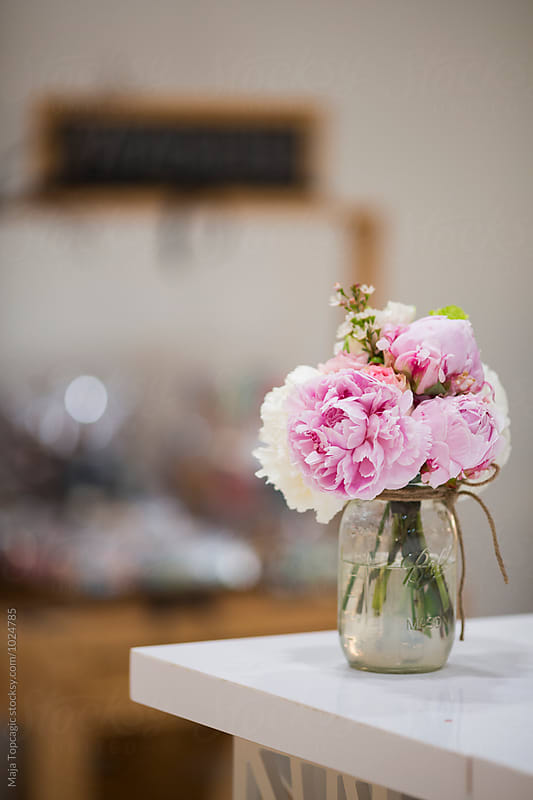 Flowers in a vase on the table  by Maja Topcagic for Stocksy United