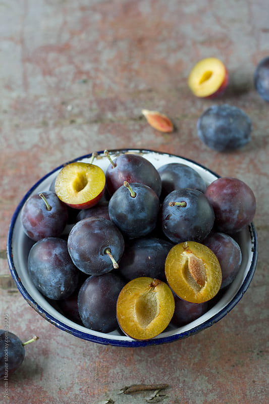 Plums in vintage bowl by Noemi Hauser for Stocksy United