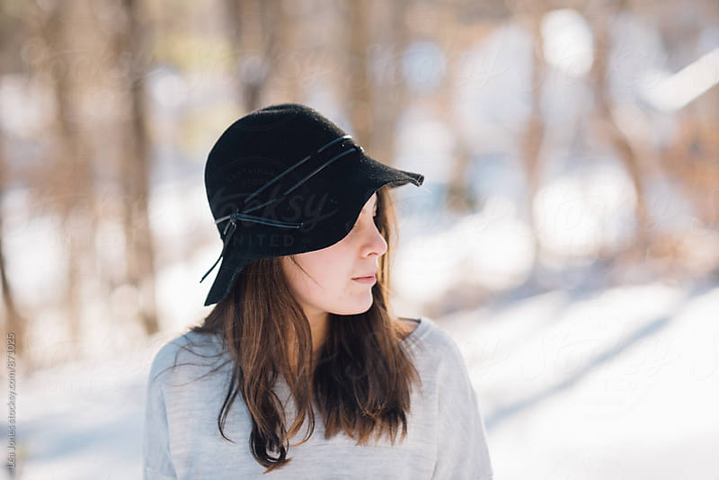 Young woman wearing a black hat by Léa Jones for Stocksy United