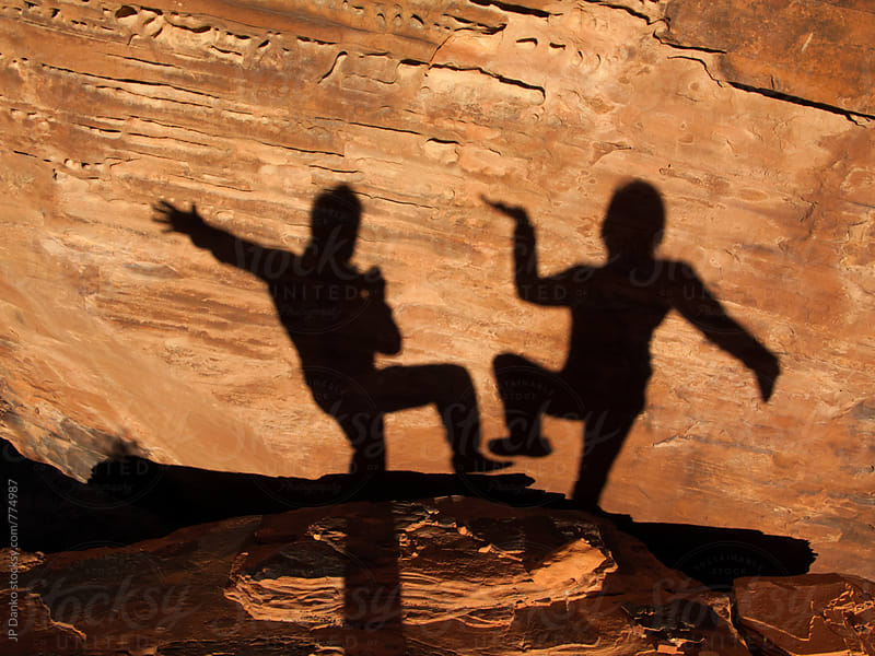 Funny Shadows of Man and Woman Posing Together in Red Rock Canyon Las Vegas Nevada by JP Danko for Stocksy United