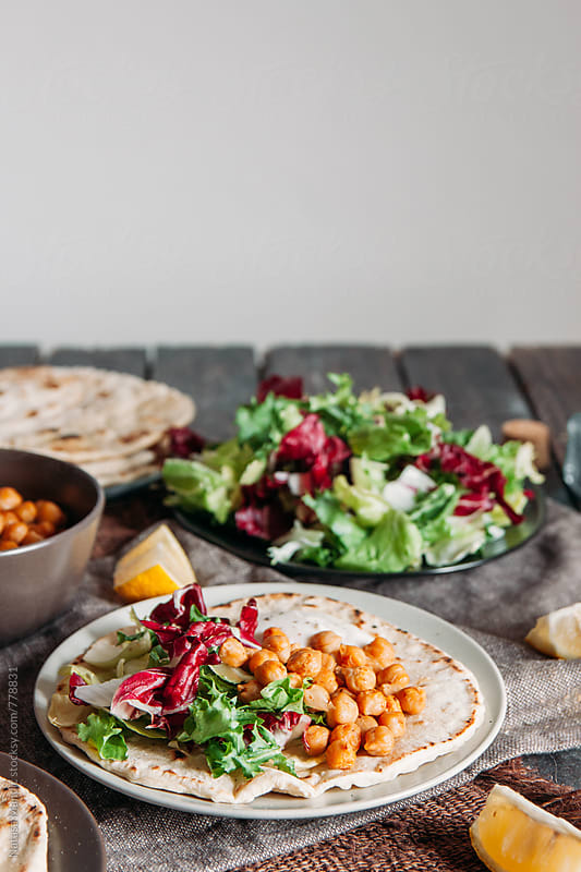 Tacos with salad and roasted chickpeas by Nataša Mandić for Stocksy United