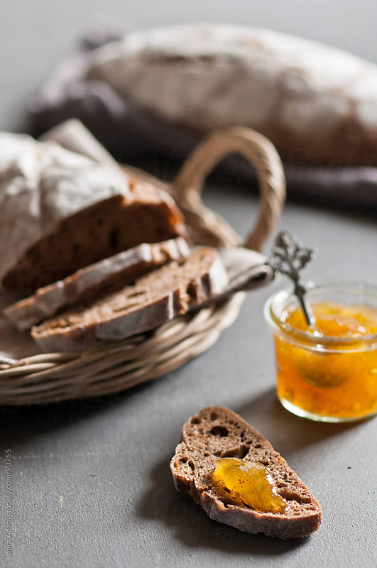 a slice of bread with fig jam by Laura Adani for Stocksy United