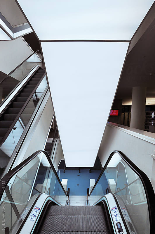 escalator stairs by Sonja Lekovic for Stocksy United