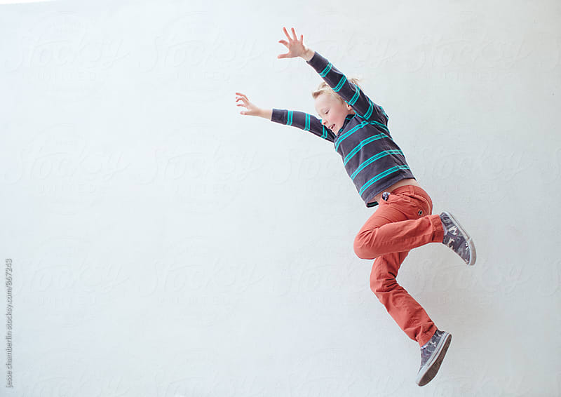 Boy Jumping by jesse chamberlin for Stocksy United
