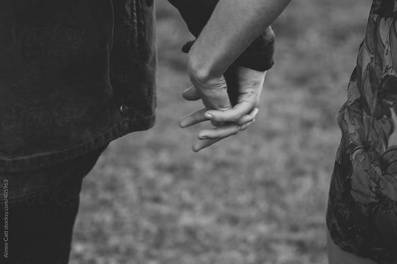 Holding hands by Aimee Catt for Stocksy United