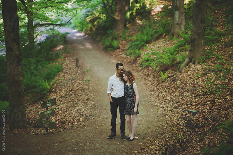 Young Adult Couple in Forest by Kevin Russ for Stocksy United