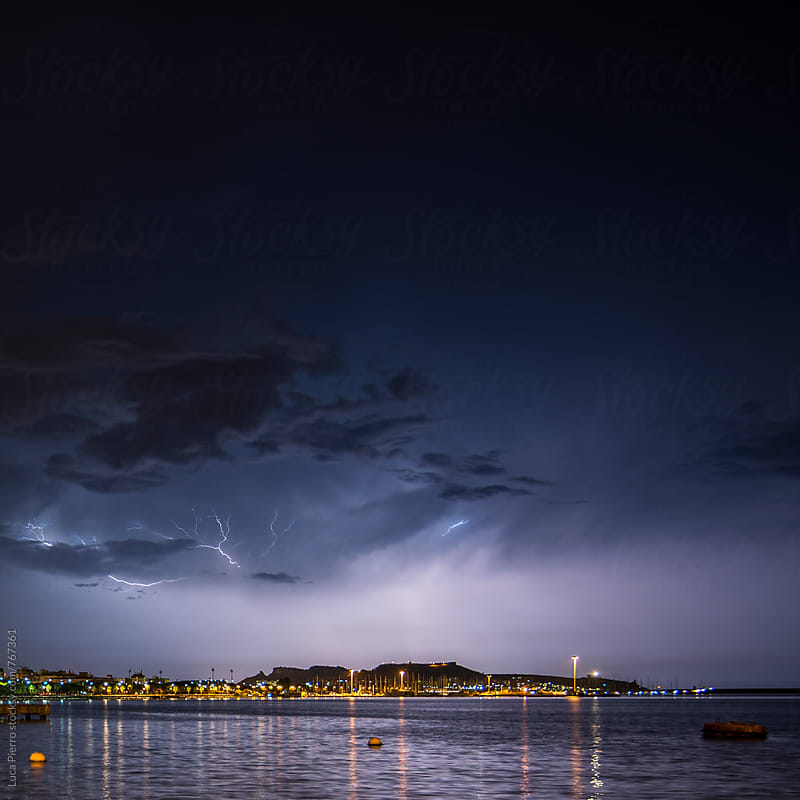 Lightning bolt over port of Cagliari, Italy by Luca Pierro for Stocksy United